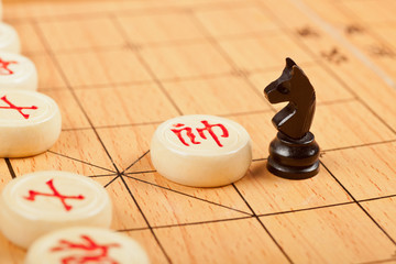 Western chess piece on Chinese chess board