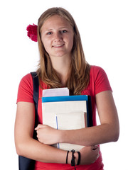Young female teenage student carrying books