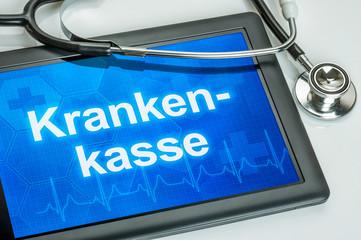 Tablet mit dem Text Krankenkasse auf dem Display