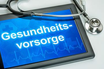 Tablet mit dem Text Gesundheitsvorsorge auf dem Display