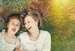 Leinwandbild Motiv cute little girl and her mother having fun on the grass in sunny