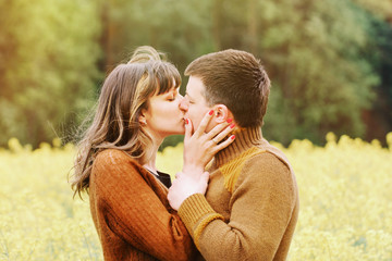 happy sensual couple kissing in love outdoor into the depth of b