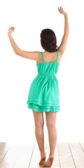 Woman in green dress barefoot, isolated on white background