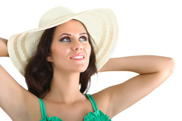 Pretty brunette girl wearing large hat isolated