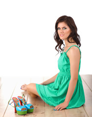 Woman wearing green dress sitting on the floor