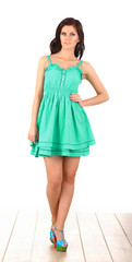 Fashion model wearing green dress