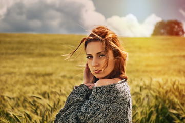 portrait of sensual young red hair woman on breathtaking view of