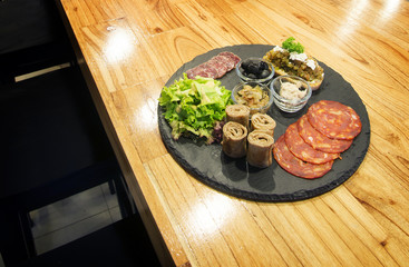 french gourmet snack foods mixed platter on wooden table