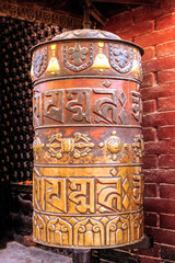 Buddhist prayer wheel at Boudhanath Temple in Kathmandu Nepal
