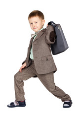 Young boy in grey suit and bow tie lifting suitcase