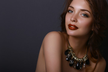 Portrait of young beautiful woman with jewelry
