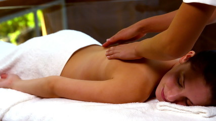 Peaceful woman enjoying a back massage at the spa