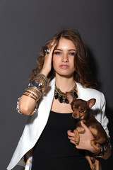 beautiful glamour woman in sunglasses with small dog