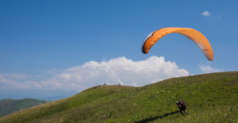 People are going to their first flight on a paraglider