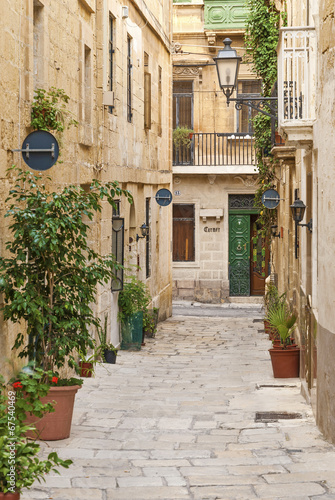 cobbled street in valetta old town malta - 67540469