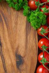 wooden board background, fresh tomatoes and herbs, vertical