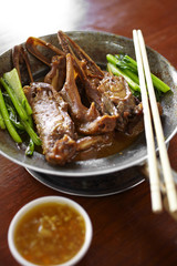 chinese duck steam and vegetable soup in metal bowl