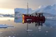 Red fishing boat around icebergs at Disko Bay, Ilulissat - 67542422