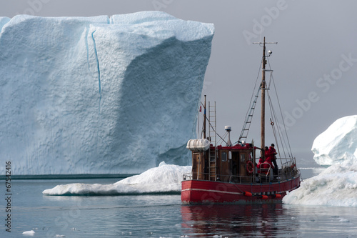 Staande foto Antarctica 2 Red fishing boat around icebergs at Disko Bay, Ilulissat