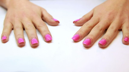 Hands showing fresh pink manicure