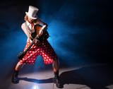 Fototapety Guitarist unusual in shorts