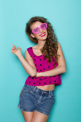Smiling sexy girl in pink sunglasses
