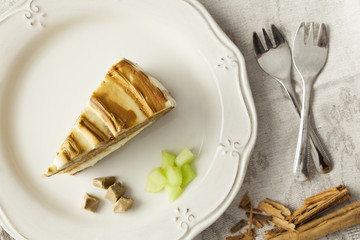 Melon and caramel cake slice with forks