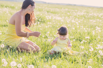 Mother and daughter with dandelions