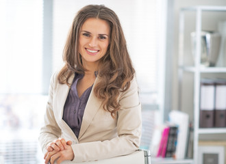 Portrait of smiling business woman in office