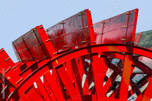 Red Riverboat Paddle Wheel in a River with Trees - 67545802