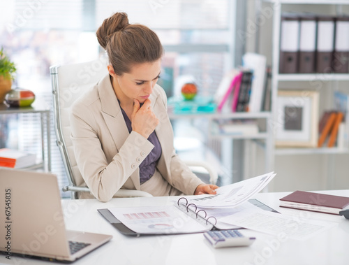 canvas print picture Thoughtful business woman documents in office