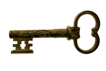 Large antique key with wine grapes decoration isolated on white