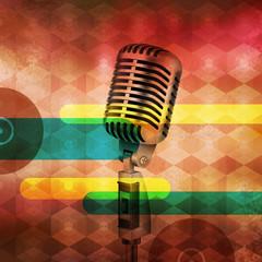 Vintage Microphone on abstract musical background