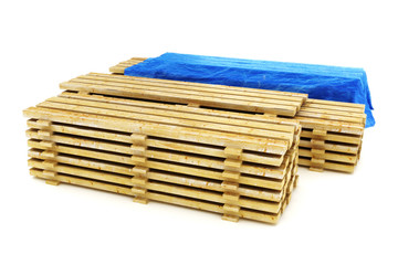Stacks of wood building lumber on a white background.