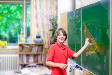 School child at math classroom