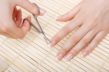 woman cuts nails scissors