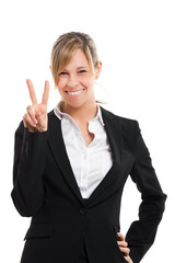 Businesswoman showing victory gesture