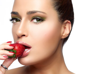 Beautiful Young Woman Eating Strawberry