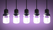 Hanging glowing spiral light bulbs on violet