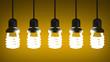 Hanging glowing spiral light bulbs on yellow
