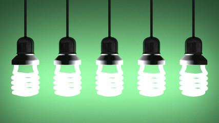 Hanging glowing spiral light bulbs on green