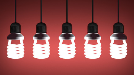 Hanging glowing spiral light bulbs on red