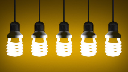 Hanging glowing spiral light bulbs on yellow