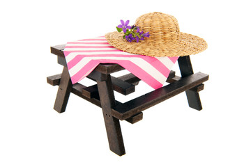 Picnic table with straw summer hat
