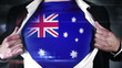 Businessman opening shirt to reveal australia flag