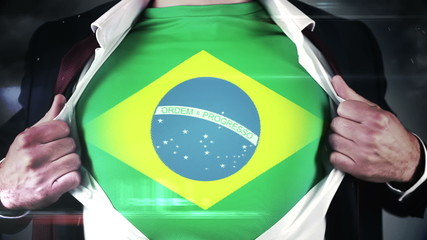 Businessman opening shirt to reveal brazil flag