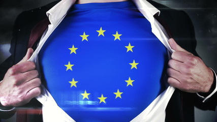 Businessman opening shirt to reveal EU flag