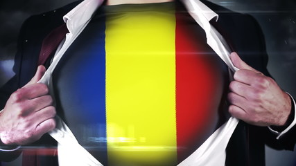 Businessman opening shirt to reveal romania flag
