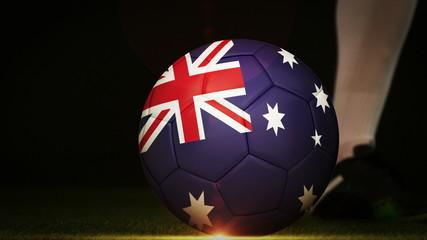 Football player kicking australia flag ball
