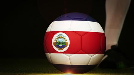 Football player kicking costa rica flag ball